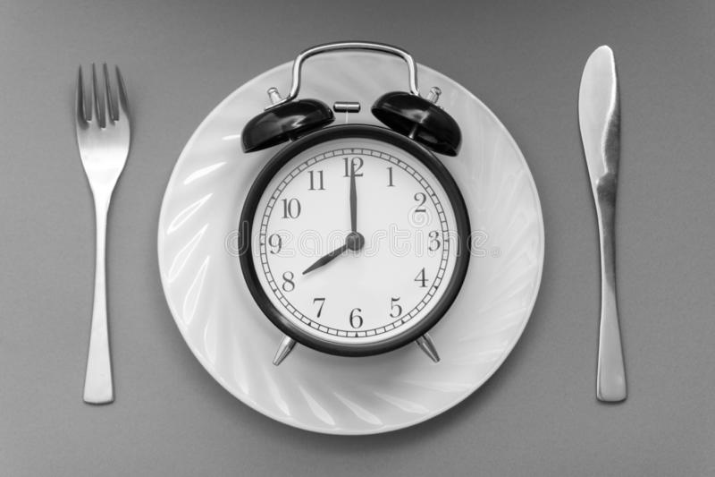 Hora de comer Almoçam o tempo, o café da manhã e o conceito do jantar fotos de stock