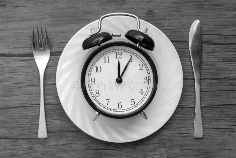 Hora de comer Almoçam o tempo, o café da manhã e o conceito do jantar foto de stock