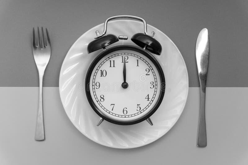 Hora de comer Almoçam o tempo, o café da manhã e o conceito do jantar fotografia de stock royalty free