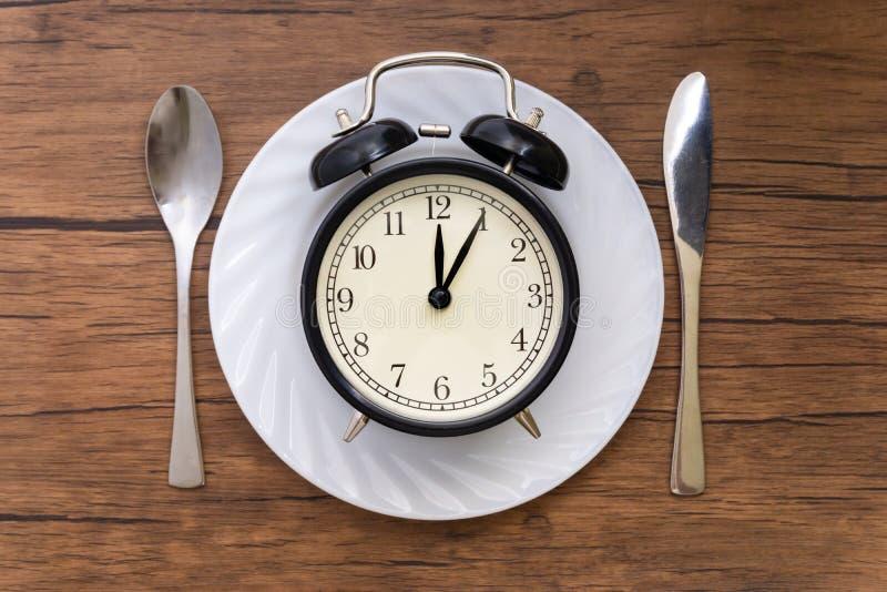 Hora de comer Almoçam o tempo, o café da manhã e o conceito do jantar fotografia de stock