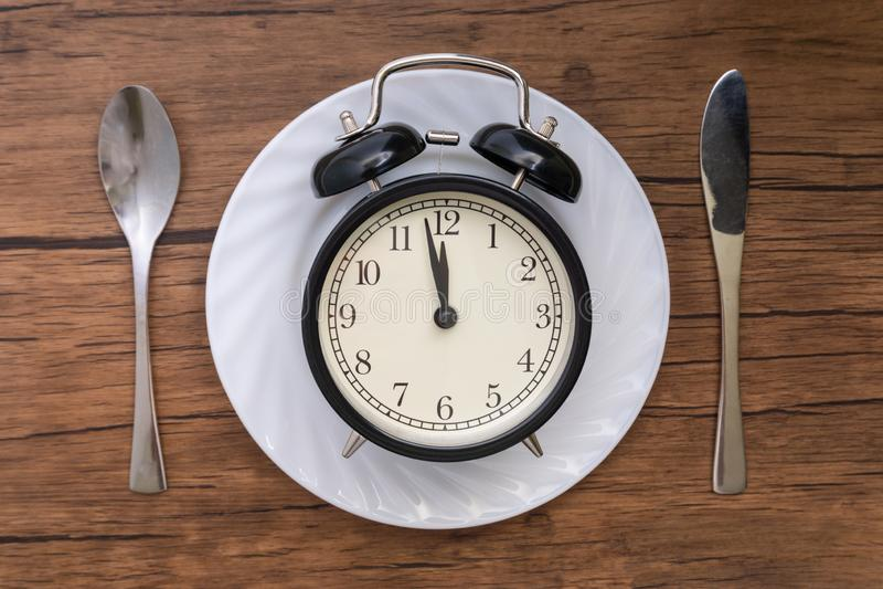 Hora de comer Almoçam o tempo, o café da manhã e o conceito do jantar imagens de stock