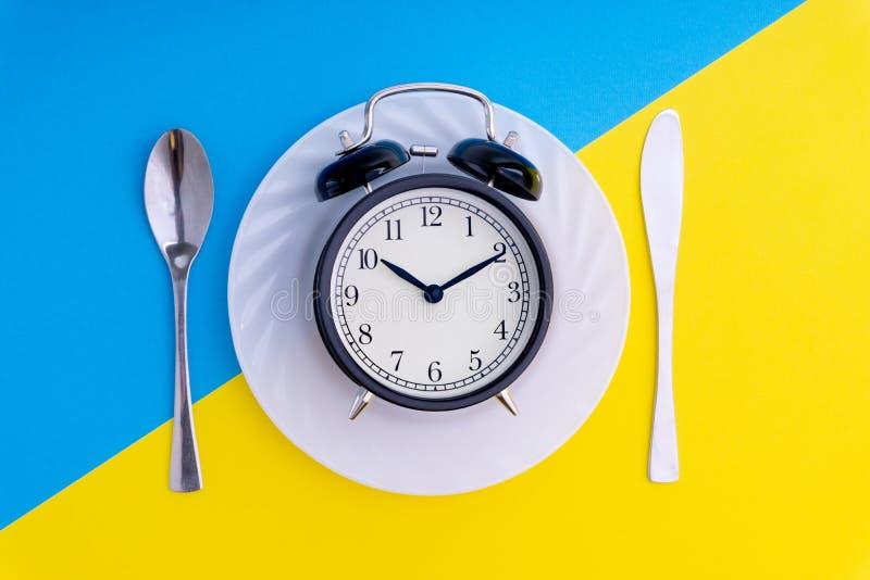 Hora de comer Almoçam o tempo, o café da manhã e o conceito do jantar imagem de stock