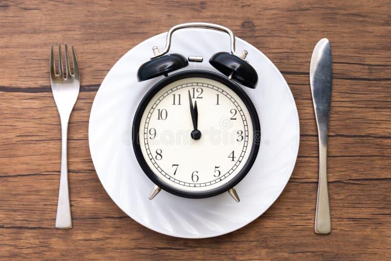 Hora de comer Almoçam o tempo, o café da manhã e o conceito do jantar imagens de stock royalty free