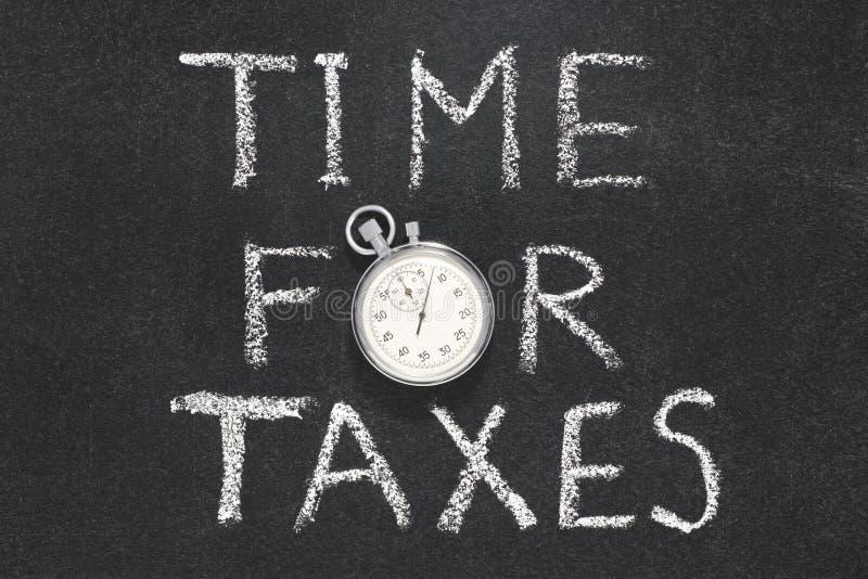 Hora para los impuestos fotografía de archivo
