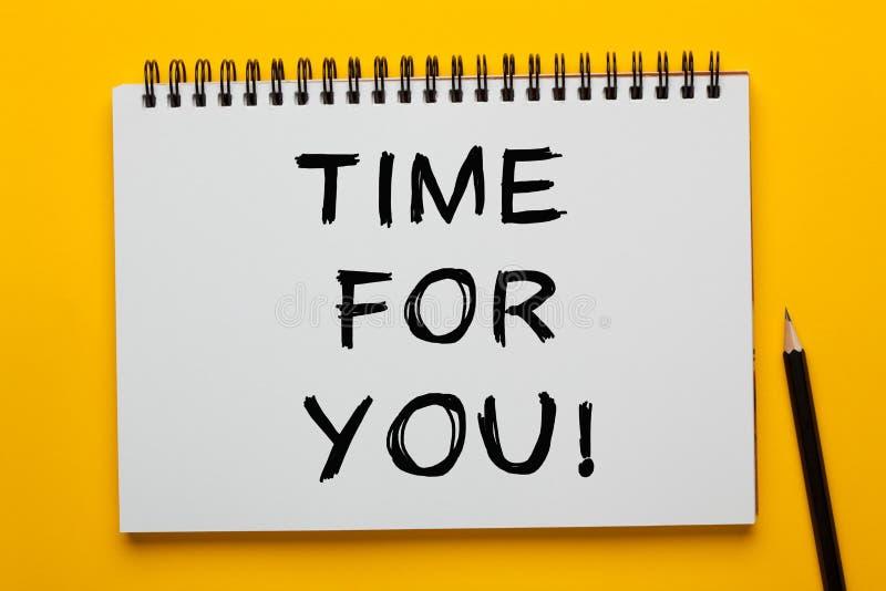 Hora para usted texto en la libreta fotografía de archivo libre de regalías