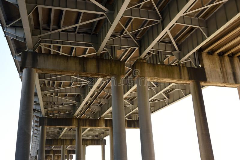 Horace Wilkinson bridge and bridge supports near Baton Rouge, Louisiana. Low angle view of the Horace Wilkinson bridge and bridge supports near Baton Rouge royalty free stock image