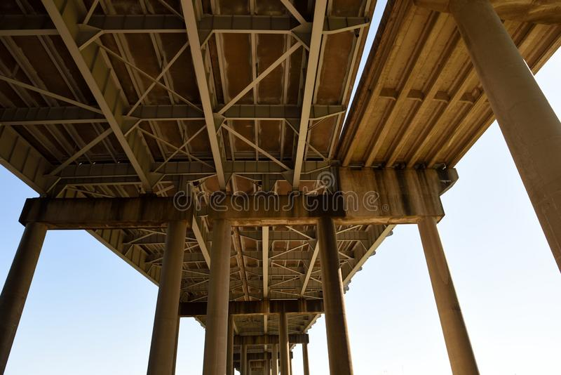 Horace Wilkinson bridge and bridge supports near Baton Rouge, Louisiana. Low angle view of the Horace Wilkinson bridge and bridge supports near Baton Rouge stock photo