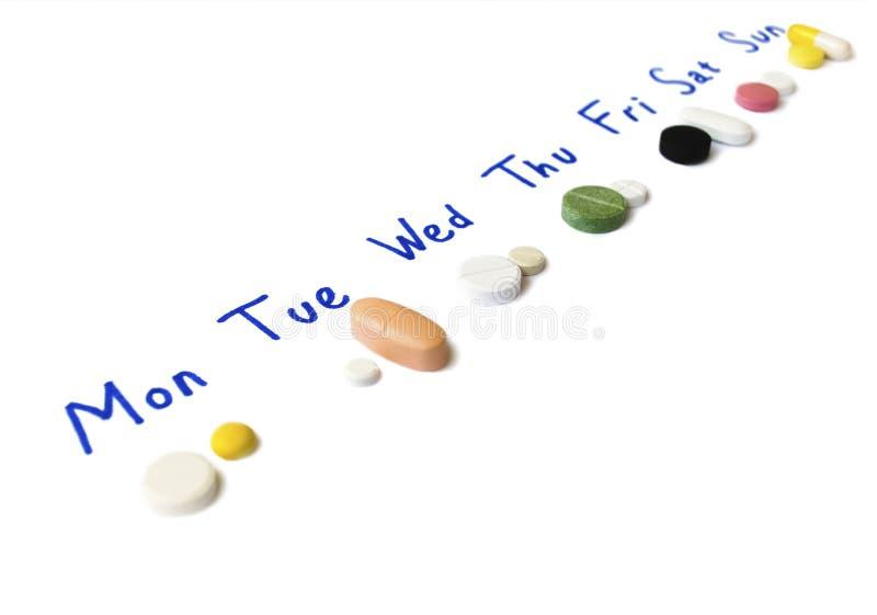 Horario de la curación de la semana escrito en la hoja del papel imagen de archivo
