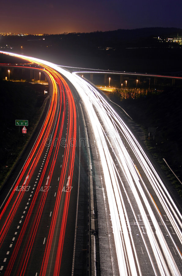 Horas de ponta na noite imagens de stock