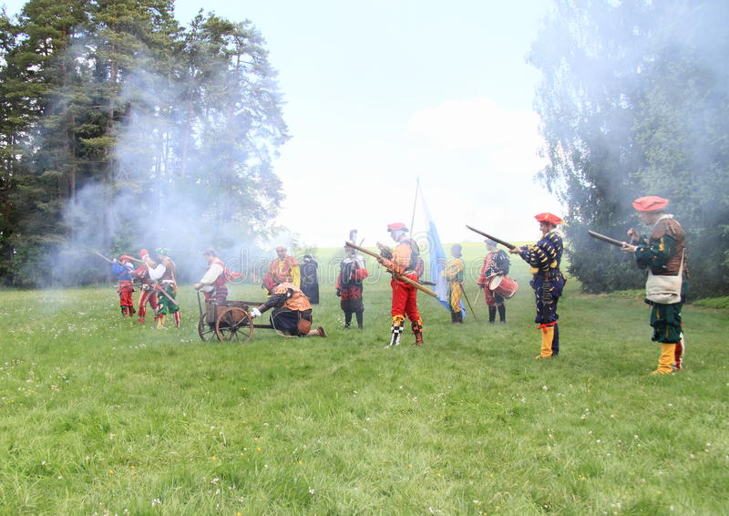 Hord of landsknechts. Shooting with arkebusa and machine-gun on meadow at Spring Landsknecht Camping at Bohdalov (Czech Republic, the 10th of May 2014 stock photography