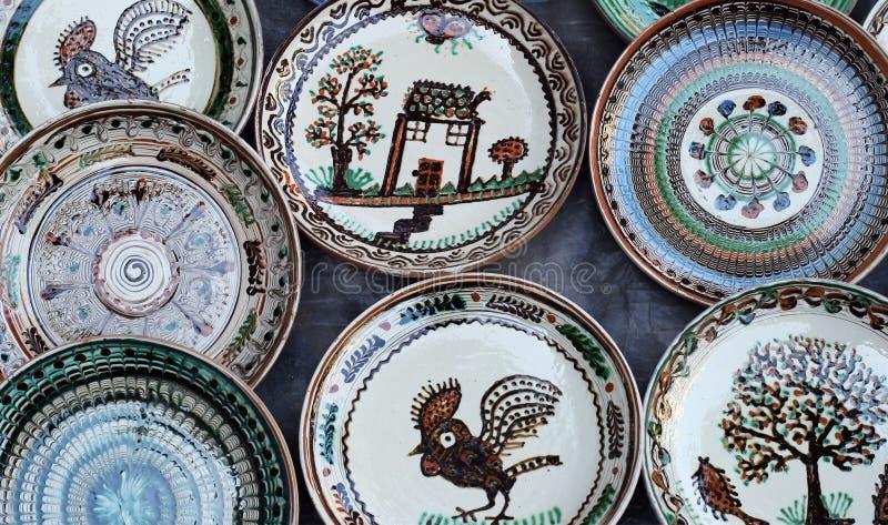 Horezu ceramic plates. Handmade ceramic plates from Horezu are on display at a fair in Bucharest, Romania, Saturday, 05 December 2015. Horezu ceramic is a royalty free stock images