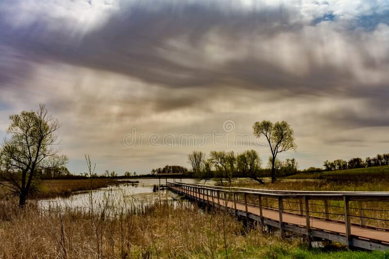 Horicon Marsh Long Pier. A beautiful partly cloudy day at the horicon marsh in Mayville Wisconsin while roaming around the visitor center stock images
