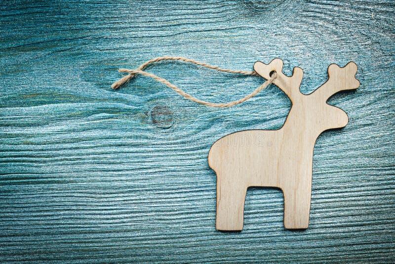 Horisontalversionen av tappningträhjortar stränger på wood brädeH royaltyfria bilder