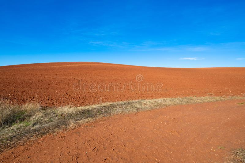 Horizon of brown earth field hill and blue sky stock image