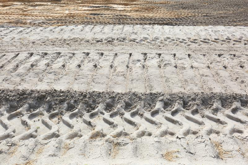 Horizon of Equipment Tracks in Sand Work Area. Tracks on the horizon of tractors, trucks and bull dozers. The tracks are very precise and clear with the lighting royalty free stock photo