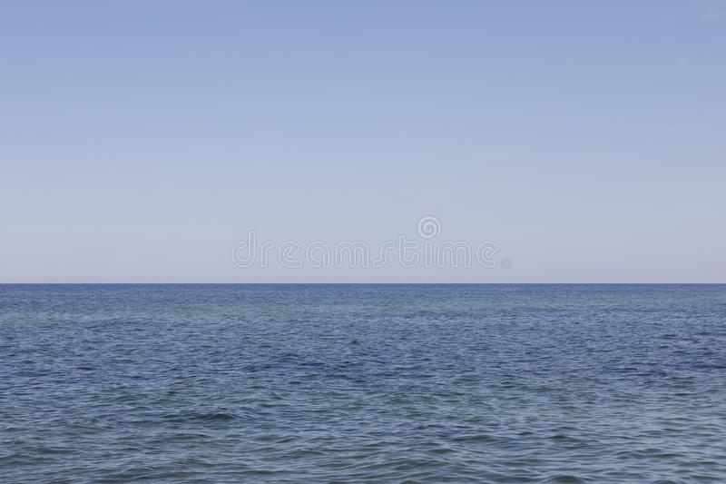The horizon line on the Baltic Sea. The horizon line separates the sky from the waters of the Baltic Sea what can be seen here on the June day in Kolobrzeg stock photography