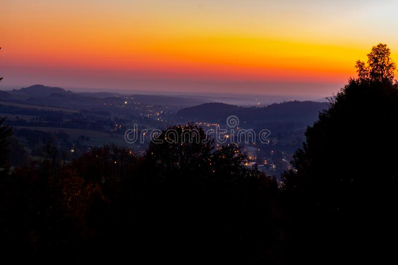 Horizon line of orange sky and clouds with beautiful golden orange sunset time with light sunrise nature royalty free stock photos