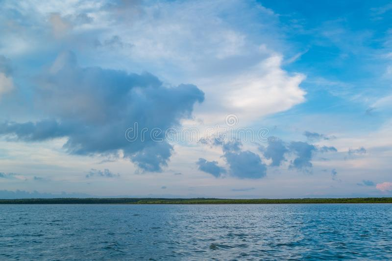 The horizon line where the sea meets the sky and the night meets the day. In the middle of nature and fresh air in thailand royalty free stock photography