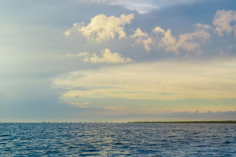 The horizon line where the sea meets the sky and the night meets the day. In the middle of nature and fresh air in thailand stock images