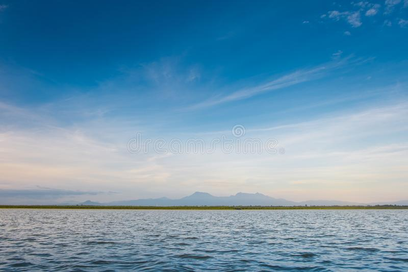 The horizon line where the sea meets the sky and the night meets the day. In the middle of nature and fresh air in thailand stock image