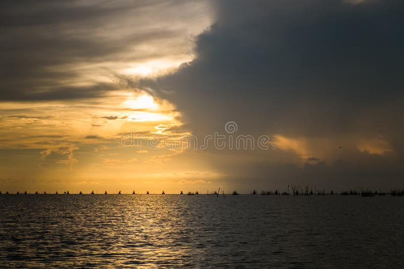 The horizon line where the sea meets the sky and the night meets the day. In the middle of nature and fresh air in thailand royalty free stock images