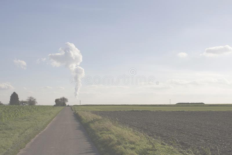 On the horizon, the steam turns into a cloud royalty free stock image