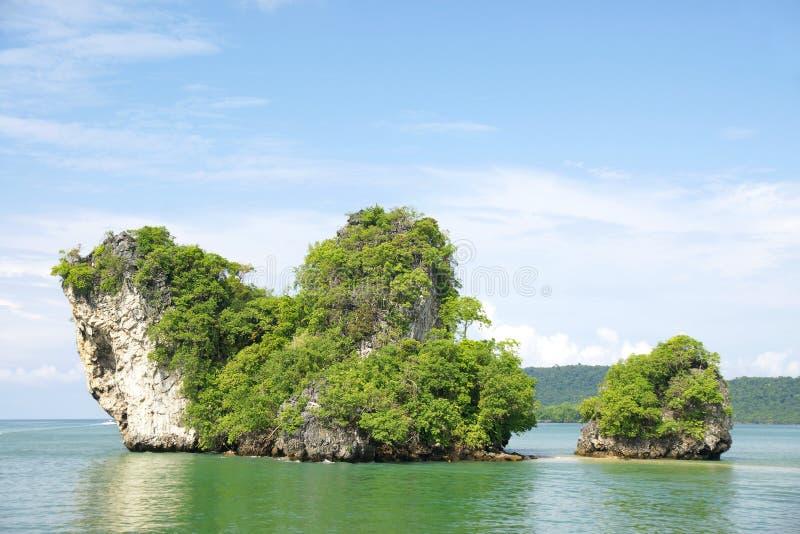 Horizon view of a big horizontal rock cliff with green vegetation, Krabi Thailand. stock image