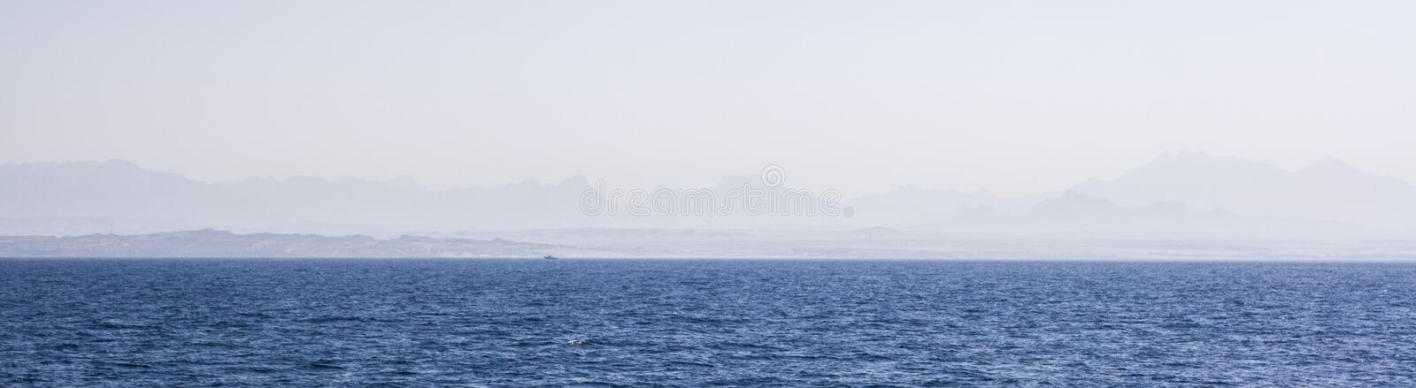 Horizont. Ocean and mountains in the horizont stock photography