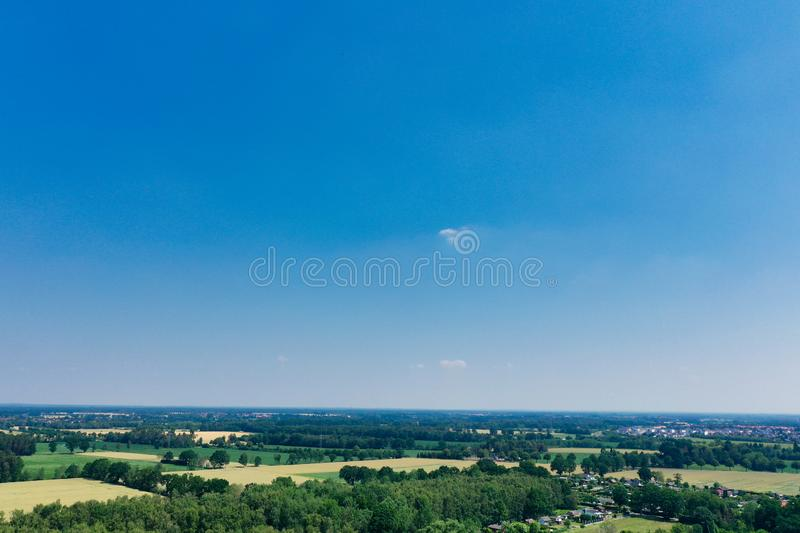 Horizontal aerial view to the horizon with blue sky, much copy space, a small cloud.  stock photography