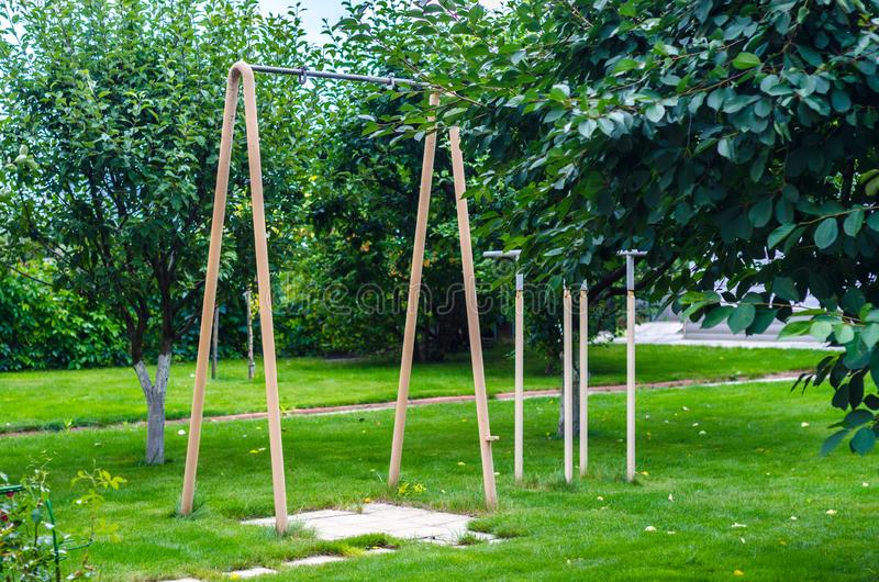 Horizontal bar in the backyard sports equipment. Green lawn royalty free stock photography