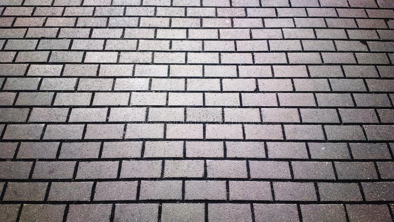 Horizontal black and white tile pavement texture background. Hd orientation vivid vibrant spacedrone808 bright rich composition design concept element object stock photos