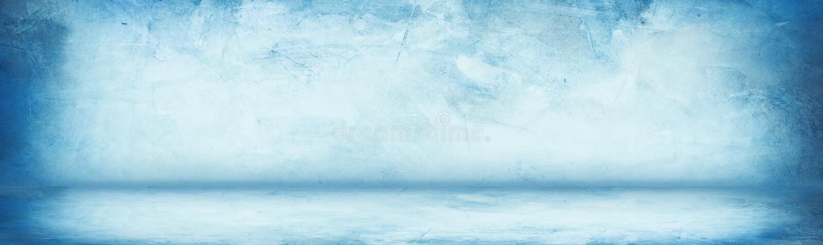Horizontal blue grunge texture cement or concrete wall banner, blank studio background.  stock illustration