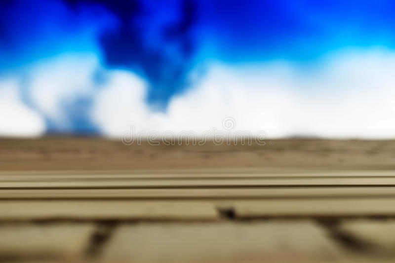 Horizontal brick wall with blue sky motion blur background royalty free stock image