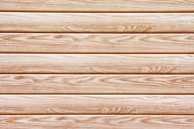 Horizontal brown wooden boards as texture, background close up stock images