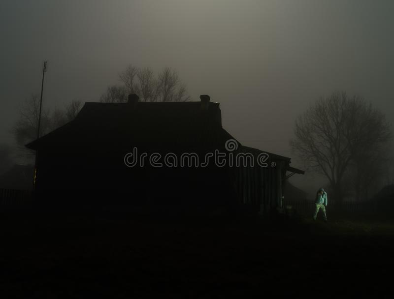 Horizontal classic zombie horror cabin with zombie scary backgro. Und house haunted old thailand abandoned nature green farm vintage landscape outdoor scene royalty free stock photo