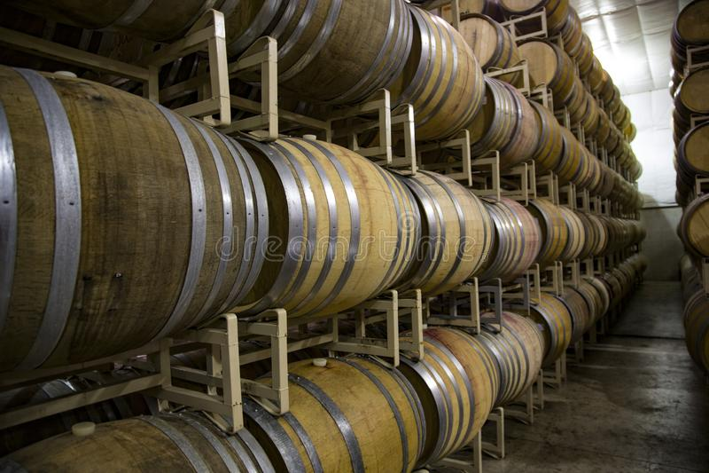 -High Stacked Rows of French Oak Wine Barrels,. Horizontal Close Up Front three-Quarter View, 4-High Stacked Rows of French Oak Wine Barrels, Clean Industrial royalty free stock photos