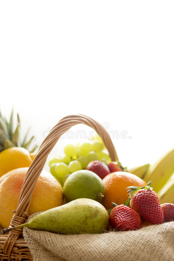 Horizontal Closeup detail on a basket full of fruit on white background stock photos