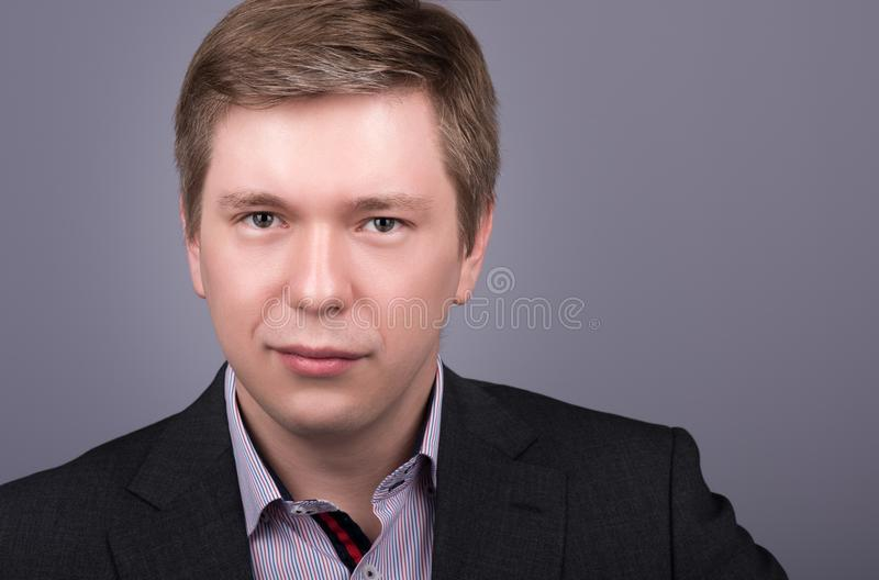 Horizontal closeup portrait young handsome man in jacket and shirt royalty free stock photo