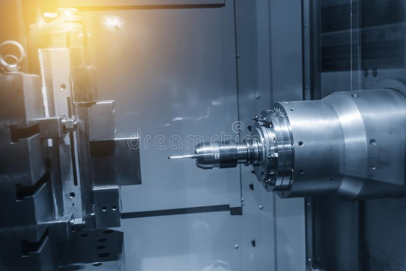 The Horizontal CNC milling machine attach the CMM probe. In the light blue scene with lighting effect.High technology manufacturing process royalty free stock image