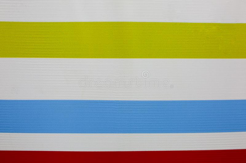 Horizontal colorful lines on the white background. Real strips painted on the wall. Bright wall paper. Children paintings and royalty free stock images