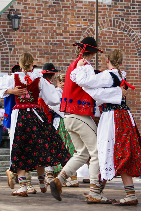 Horizontal colour image of female polish dancers in traditional. Folklore costumes on stage stock images