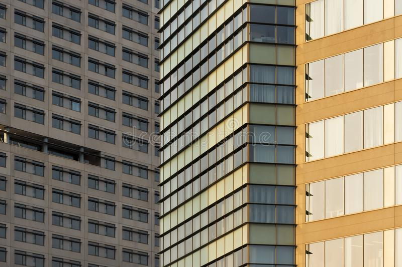 Background of overlapping concrete facades. Horizontal composition with a close-up of facades of concrete buildings to use as a background. One of the buildings stock image