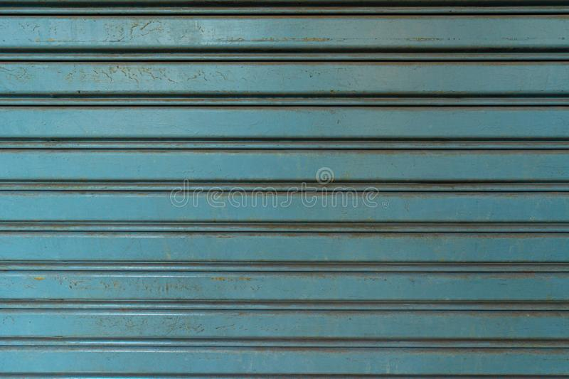 Horizontal corrugated fence of blue metal sheets. royalty free stock photo
