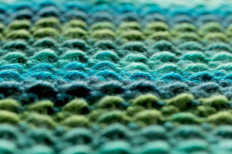 Horizontal Crochet Yarn Rows. Close-up of blue and green crocheted yarn rows stock images