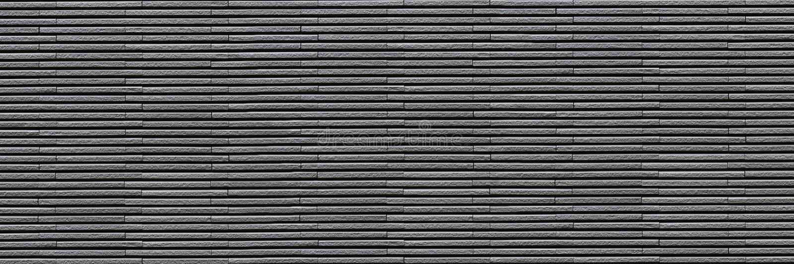 horizontal dark gray modern brick wall for pattern and background royalty free stock image