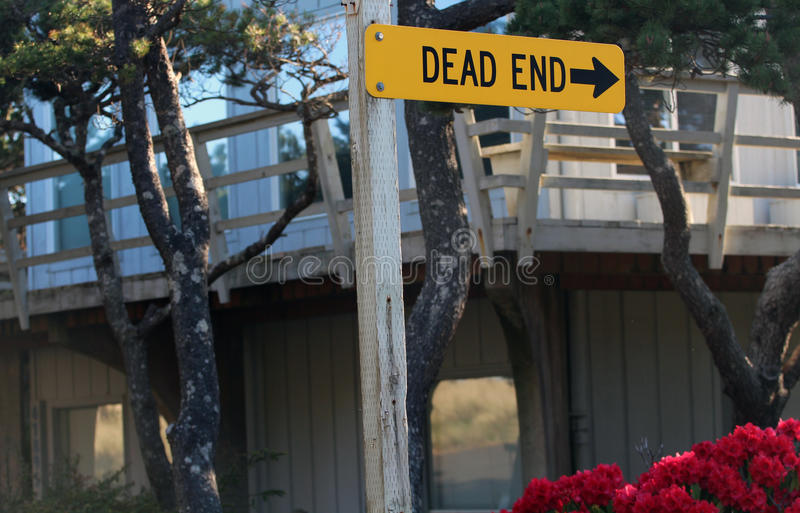 Horizontal Dead End Street Sign on a wooden post. Horizontal Dead End Street Sign on a wooden post with an arrow pointing royalty free stock photo