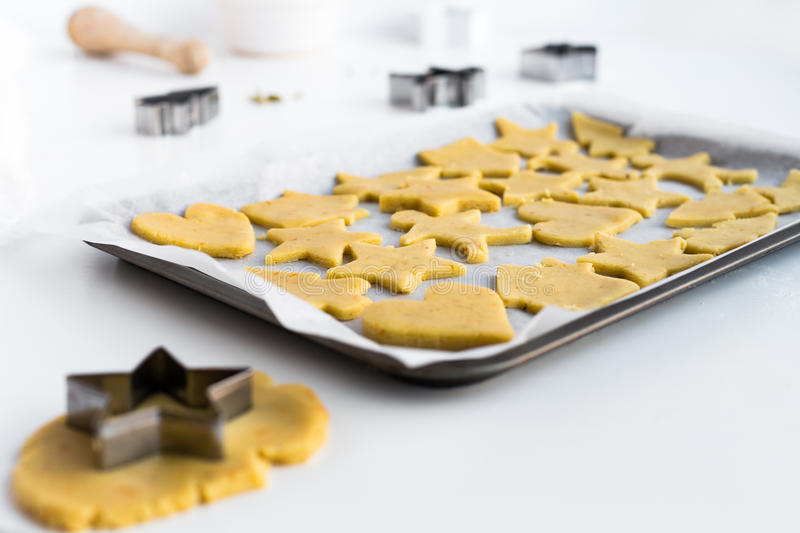 Horizontal Food Scene of Festive Biscuits on Baking Tray ready for Cooking. Horizontal food scene of christmas biscuits on baking tray ready for cooking royalty free stock photography