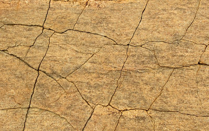 A horizontal frame of cracked rock texture natural background. stock image