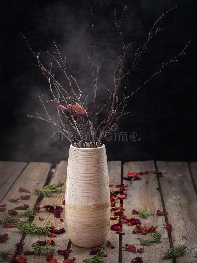 Free Horizontal Frame Of A Beige Ceramic Vase With Dry Branches, Standing On A Wooden Plank Table Stock Image - 140382471