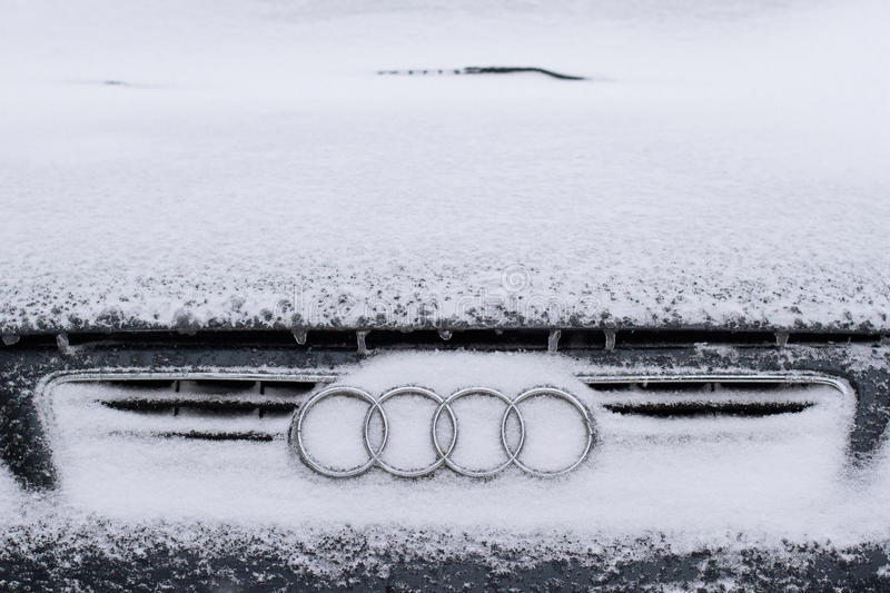 Horizontal front view of Audi logo covered in snow royalty free stock image